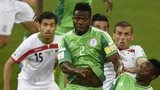Nigeria's defender Joseph Yobo and Nigeria's forward Ahmed Musa (right) fights for the ball