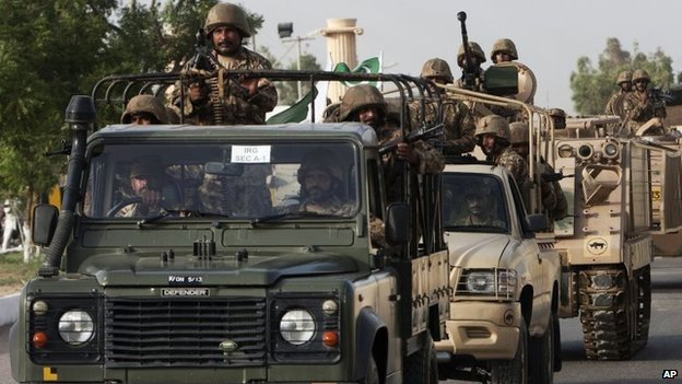 Pakistani army troops ride military vehicles following an operation launched against the Taliban in North Waziristan, in Karachi, Pakistan, 16 June 2014