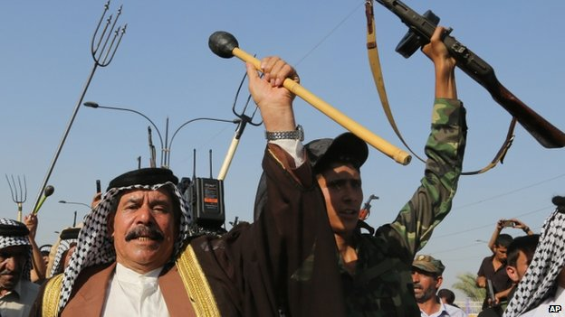 Shias chant slogans against ISIS in the north-western Baghdad suburb of Shula