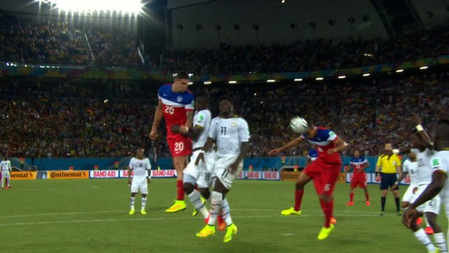John Brooks heads a goal for the United States