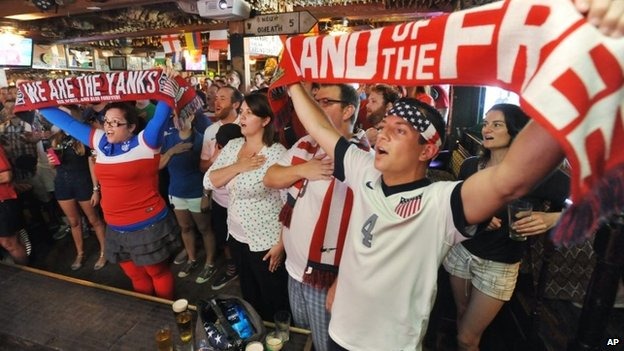 United States soccer fans sing the national anthem before the World Cup match against Ghana Lynch's Irish Pub in Jacksonville Beach, Florida 16 June 2014