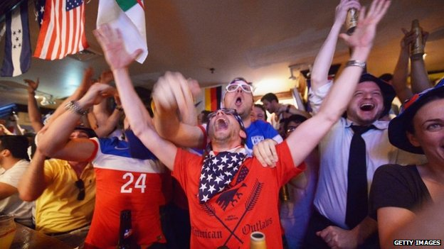 Soccer fans cheer for team US as they face Ghana during the World Cup in Brazil at Jack Dempsey's bar in New York City 16 June 2014