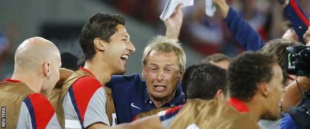 USA manager Jurgen Klinsmann celebrates his side's win over Ghana