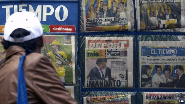 A man looks at newspapers in Bogota on 16 June, 2014