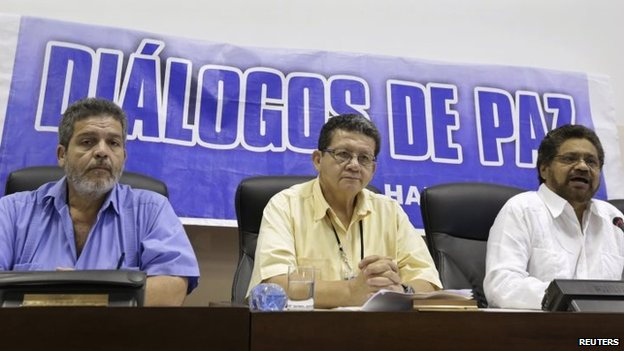 FARC negotiator Ivan Marquez (right) speaks to the media beside fellow negotiators Pablo Catatumbo (centre) and Marcos Carratala during a news conference in Havana on 7 June, 2014.