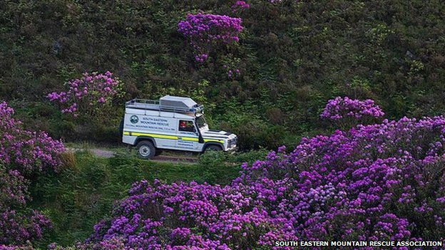 South Eastern Mountain Rescue Association vehicle in rhododendron forest