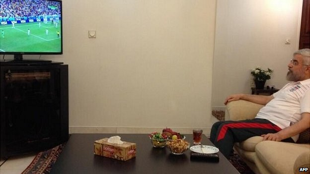 Iranian president Hassan Rouhani watching the country's football team play Nigeria in the 2014 World Cup