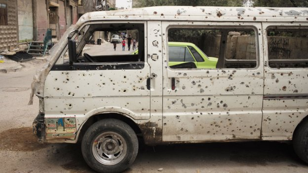 Van with bullet holes in Qaboun
