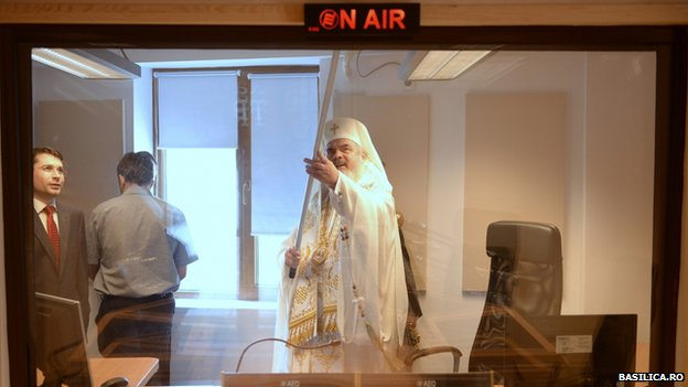 The patriarch anoints a radio studio