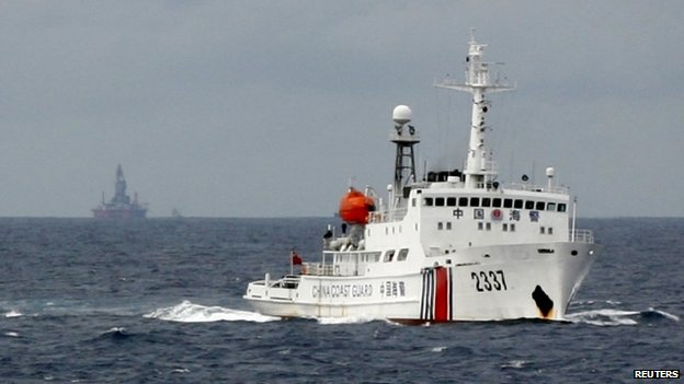 A Chinese Coast Guard vessel passes near the Chinese oil rig, Haiyang Shi You 981 in the South China Sea on 13 June 2014.