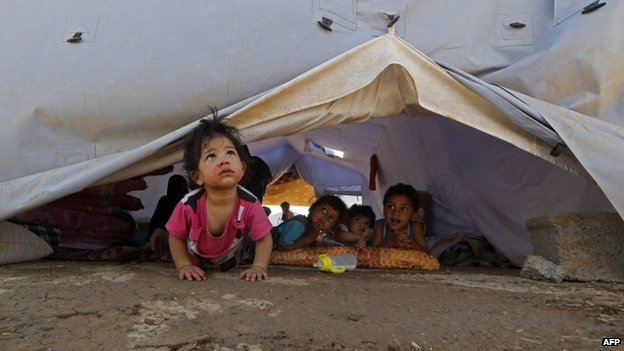 Displaced Iraqi children inside a UNHRC tent at a temporary camp near Arbil (17 June 2014)