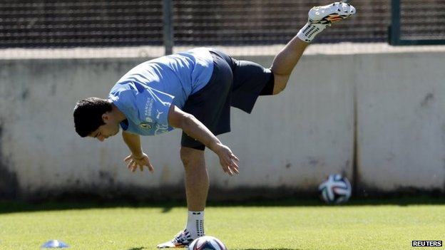 Uruguay's Luis Suarez exercises during a training session at Jacare stadium in Sete Lagoas, near Belo Horizonte, on 15 June, 2014