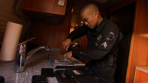 Officer removes hard drive