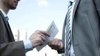Handing over cash