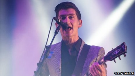 Alex Turner of the Arctic Monkeys performs live on the Pyramid Stage at day 2 of the 2013 Glastonbury Festival
