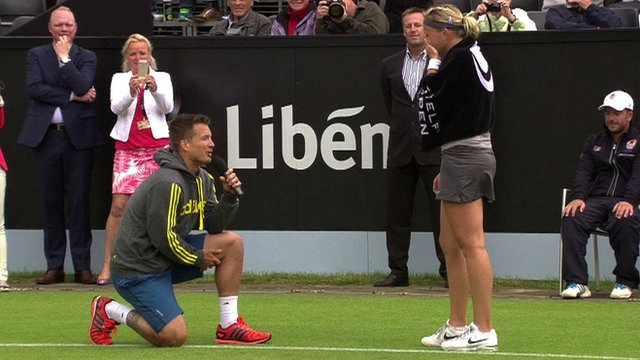 Martin Emmrich proposes to Michaella Krajicek on court