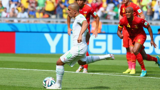 Algeria's Sofiane Feghouli gives his side the lead from the spot against Belgium