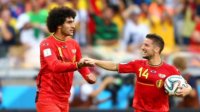 Marouane Fellaini and Dries Mertens celebrate as Belgium beat Algeria 2-1 at the 2014 Fifa World Cup in Brazil