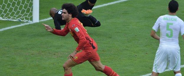 "Belgium's midfielder Marouane Fellaini (front left) celebrates after scoring his team""s first goal"