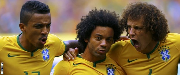 (left to right) Luiz Gustavo, Marcelo and David Luiz sing the national anthem