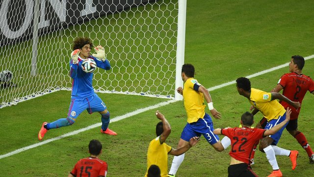 Mexico goalkeeper Guillermo Ochoa denies Brazil.