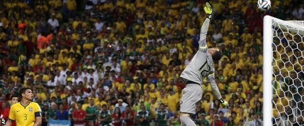 Brazil goalkeeper Julio Cesar tips over a Hector Herrera shot