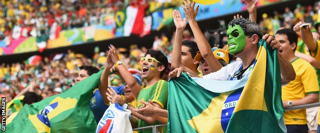 Brazilian fans cheer on their side during their World Cup group A match against Mexico