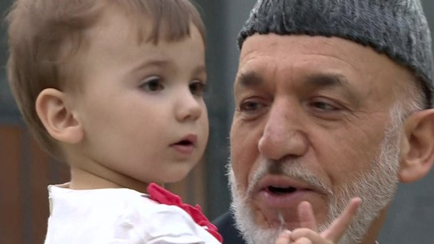 Hamid Karzai with a member of his young family