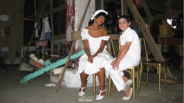 Two cast members of Carmen Jones relax during a break in June 2014
