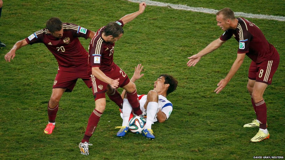 Russia's Victor Faizulin (left) and Dmitry Kombarov fight for the ball with South Korea's Park Chu-young during their 2014 World Cup football match at the Pantanal arena in Cuiaba