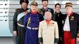 Six historical characters stand in a line-up