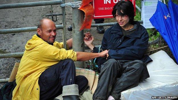 Natalie Hynde and her friend Simon Medhurst glue themselves together at Balcombe
