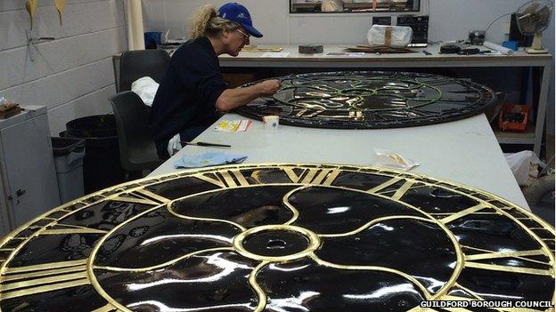 Man restoring Guildford town clock