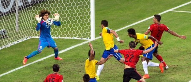 Brazil's Thiago Silva is denied by Mexico keeper Guillermo Ochoa