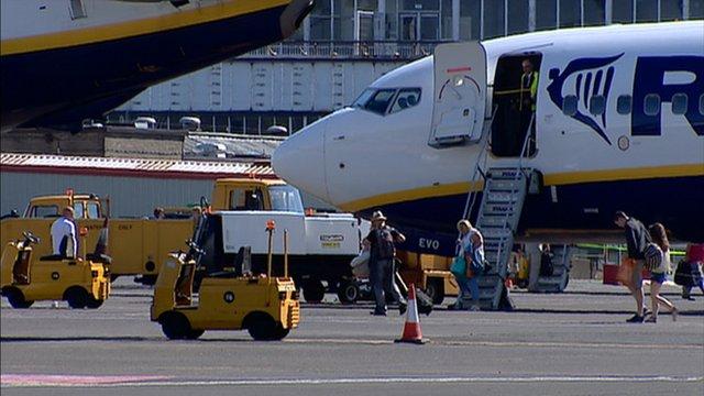 Passengers disembark a plane