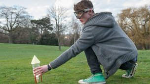 Ben Ford holding model rocket
