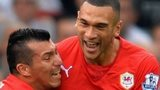 Gary Medel and Steven Caulker celebrate a Cardiff City goal