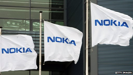 Nokia flags at the company's headquarters