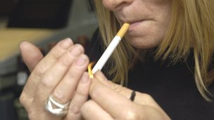 Woman lighting a cigarette