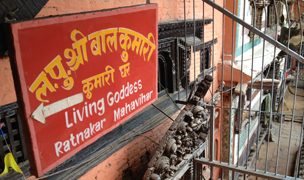 Sign reading 'living goddess'