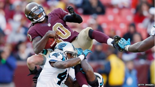 Quarterback Robert Griffin III of the Washington Redskins was tackled in Landover, Maryland, on 4 November 2012