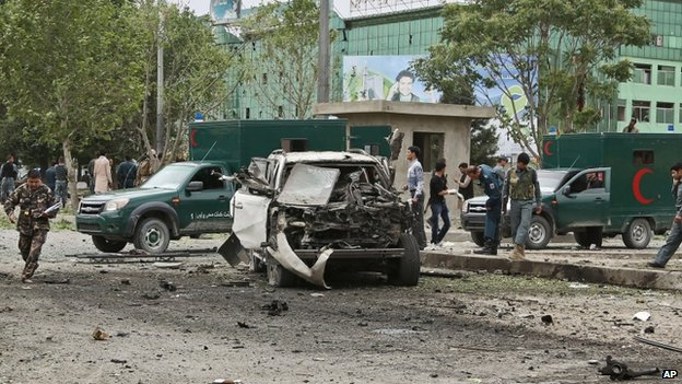 Afghan security personnel investigate the site of a suicide attack in Kabul. Photo: 6 June 2014