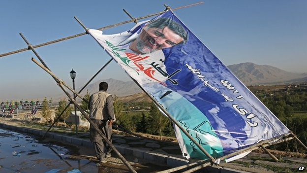 A man walks past a fallen election poster in Kabul. Photo: 9 June 2014