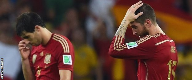 Spain's players cut dejected figures after their World Cup exit