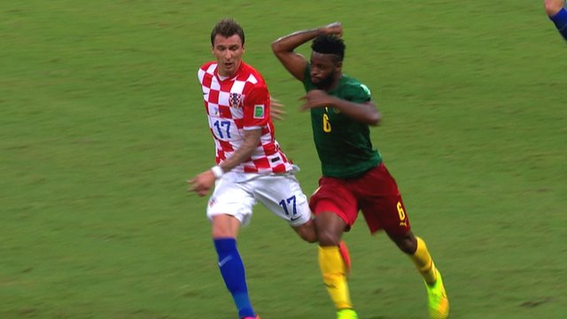 Cameroon's Alex Song sees red after punching Croatia's Mario Mandzukic