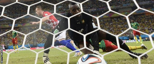 "Cameroon's goalkeeper Charles Itandje looks at the ball after Croatia""s forward Ivica Olic scores"