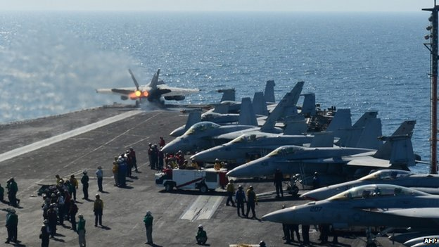 The flight deck of the aircraft carrier USS George HW Bush during flight operations in the Arabian Gulf (17 June 2014)