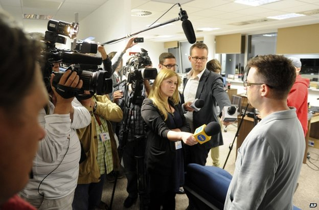 Wprost journalist Marcin Dzierzanowski briefs media at the magazine's offices in Warsaw, 18 June
