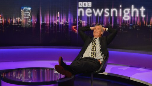 Paxman with his feet on the desk