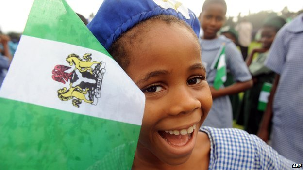 A Nigerian student smiles as she attends independence day celebrations in Lagos on 1  October  2013